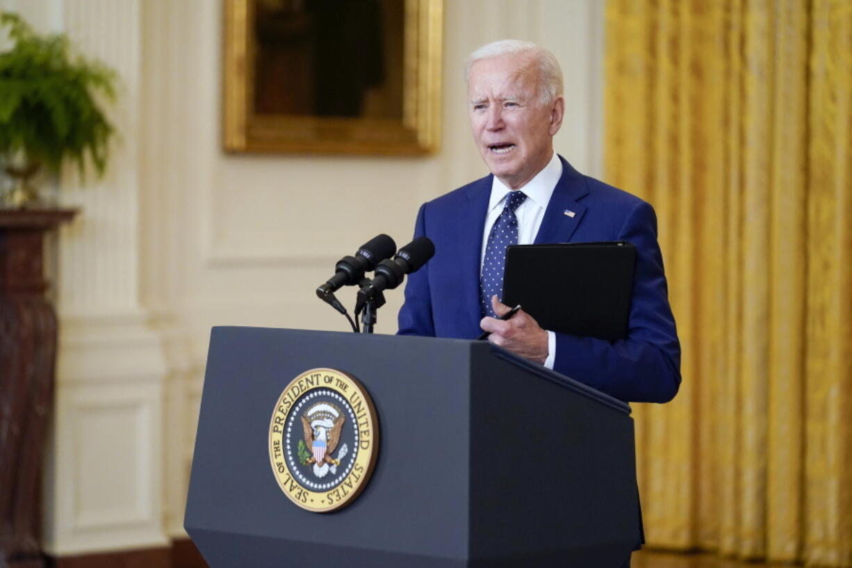 In this April 15, 2021, photo, President Joe Biden speaks about Russia in the East Room of the White House in Washington. Biden is being forced to go virtual for many of his leader-to-leader talks during the pandemic and the resulting Zoom meetings just aren't a natural fit for the back-slapping politician. Biden's big climate summit this week with dozens of world leaders is a moment for him to play cheerleader in the fight against global warming.
