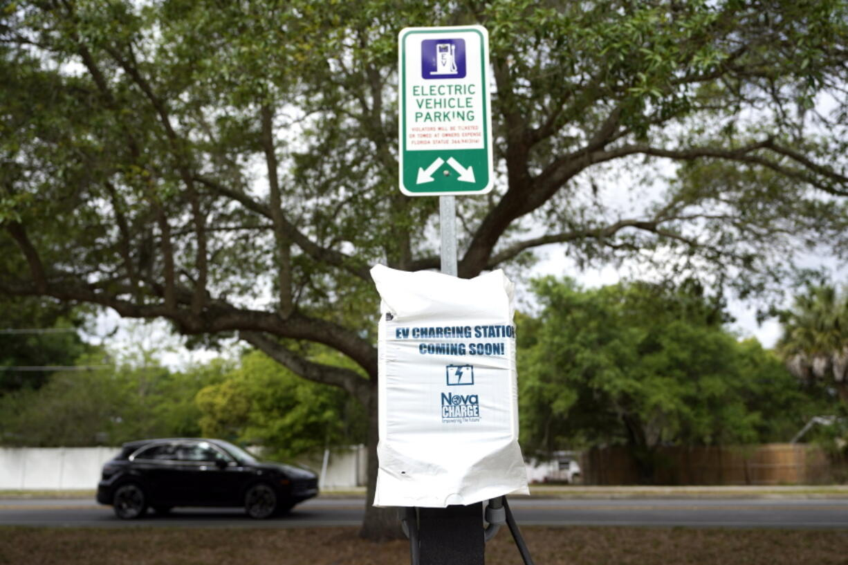 A parking area with charging stations for electric vehicles at a public park is seen Thursday, April 1, 2021, in Orlando, Fla. As part of an infrastructure proposal by the Biden administration, $174 billion will be set aside to build 500,000 electric vehicle charging stations, electrify 20% of school buses and electrify the federal fleet, including U.S.