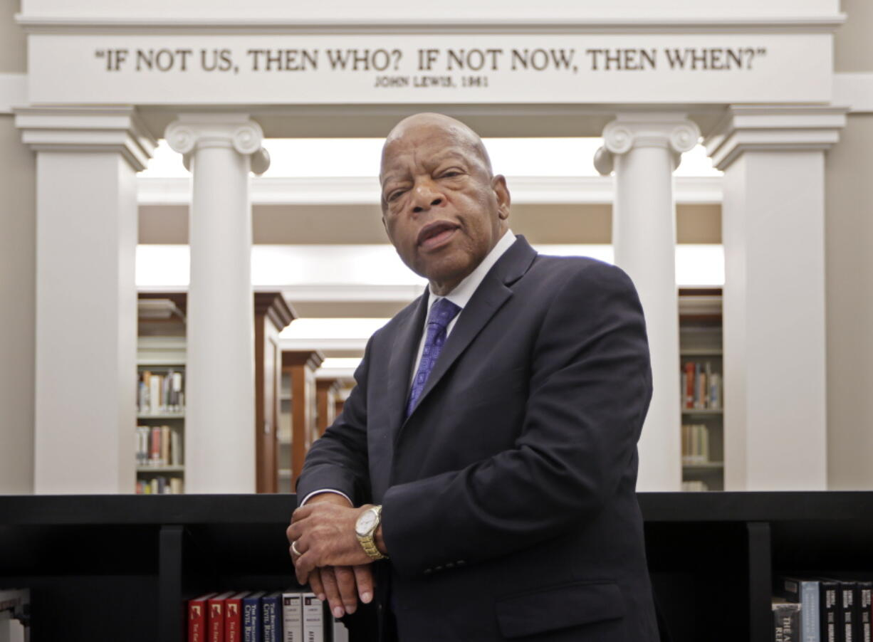 """FILE - This Nov. 18, 2016 file photo shows Rep. John Lewis, D-Ga., in the Civil Rights Room in the Nashville Public Library in Nashville, Tenn. The award-winning graphic novels about the congressmen and civil rights activist John Lewis will continue a year after his death. Abrams announced Tuesday that """"Run: Book One"""" will be published Aug. 3, just over a year after Lewis died at age 80."""