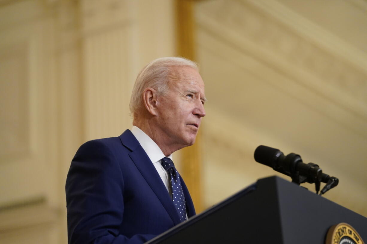 President Joe Biden speaks in the East Room of the White House, in Washington, Thursday, April 15, 2021. More than a dozen Senate Democrats sent a letter on Friday, April 16, 2021, to Biden highlighting the woeful environmental track record of his Brazilian counterpart and urging him to condition any support for Amazon preservation on significant progress reducing deforestation.