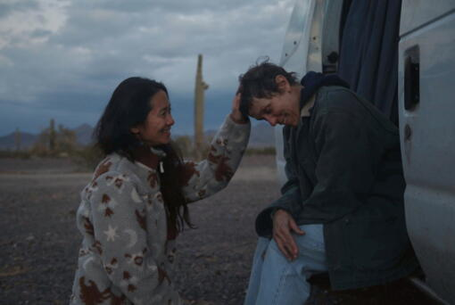 """Director Chloe Zhao, left, appears with actress Frances McDormand on the set of """"Nomadland."""" (Apple)"""