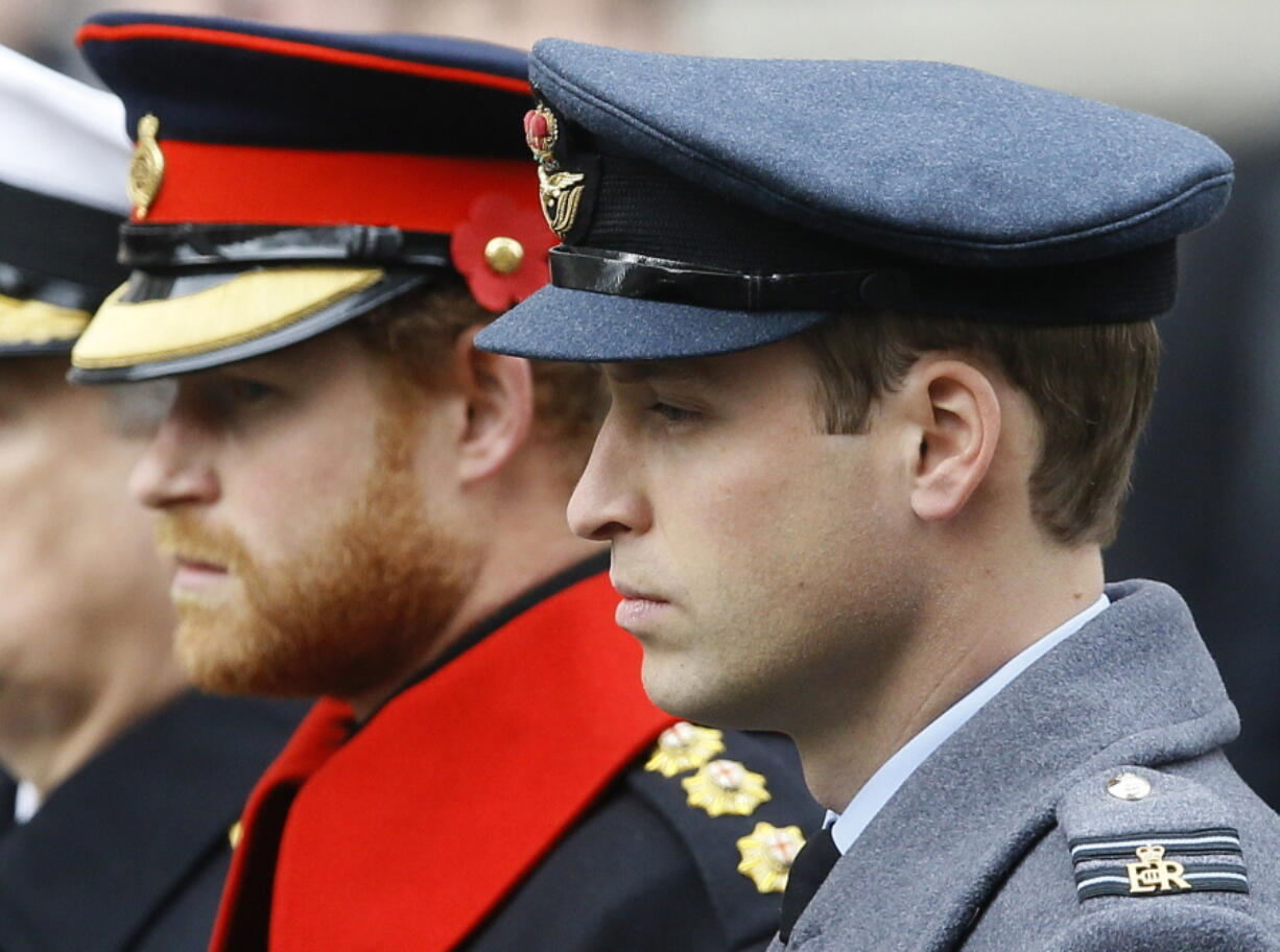 FILE - In this Sunday Nov. 8, 2015 file photo, Britain's Prince William, right, and Prince Harry attend the Remembrance Sunday ceremony at the Cenotaph in London. Senior royals must wear civilian clothes to Prince Philip's funeral, defusing potential tensions over who would be allowed to don military uniforms. Queen Elizabeth II's decision means Prince Harry won't risk being the only member of the royal family not in uniform during the funeral on Saturday April 17, 2021 for his grandfather, who died last week at the age of 99.