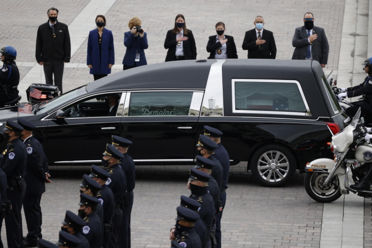 """A hearse carrying the casket of slain U.S. Capitol Police officer William """"Billy"""" Evans arrives at the Capitol, Tuesday, April 13, 2021 in Washington."""