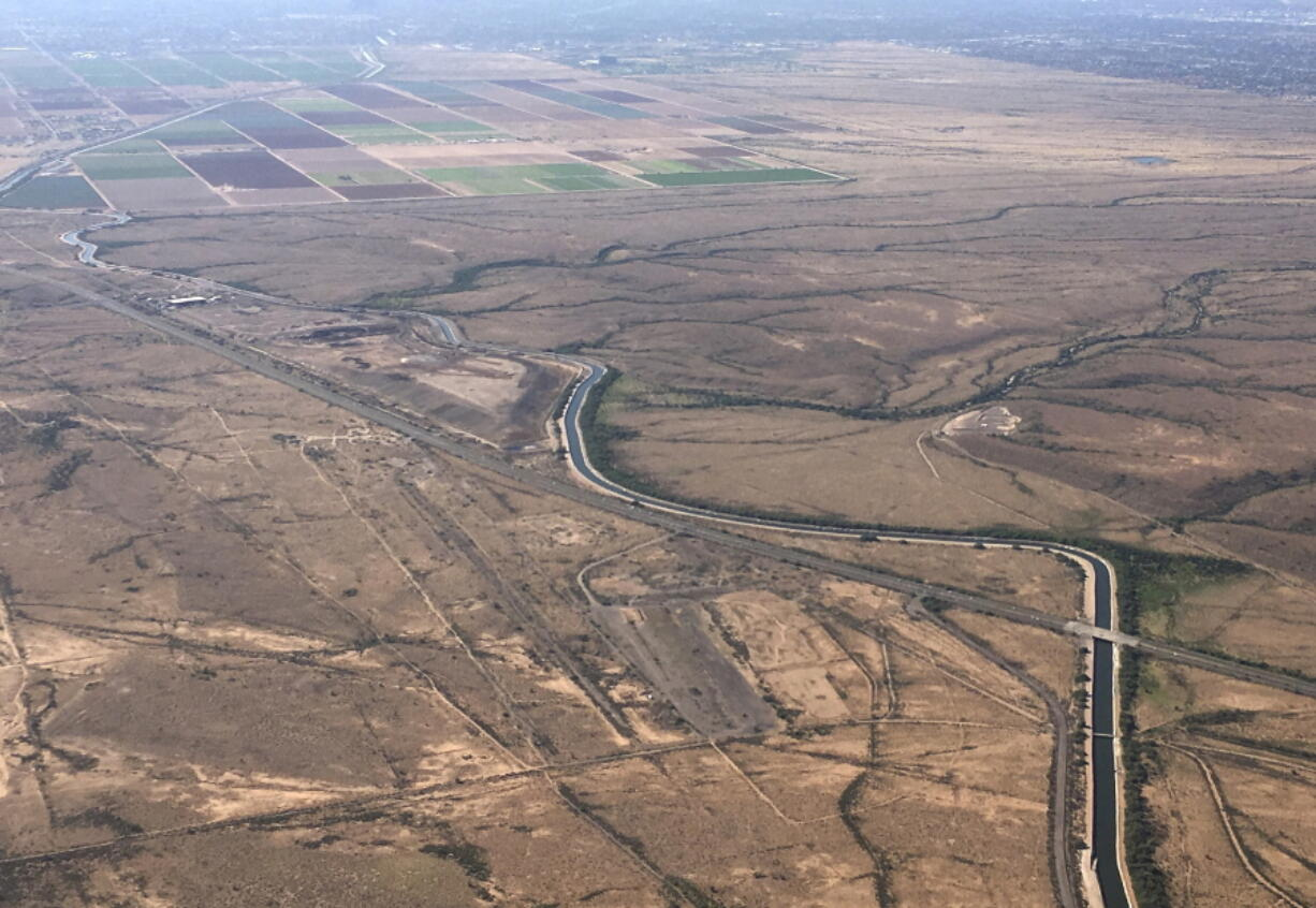 The Central Arizona Project canal runs through rural desert near Phoenix on Oct. 8, 2019. Officials in Arizona say they could lose about one-fifth of the water the state gets from the Colorado River.