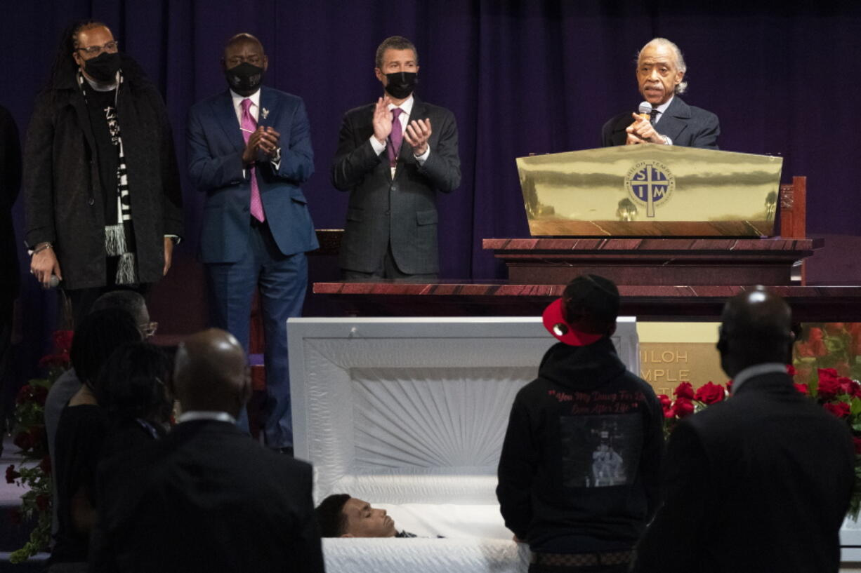 The Rev. Al Sharpton, right, speaks over the casket of Daunte Wright, alongside attorneys Antonio Romanucci, center, and Ben Crump, center left, and the Rev. Greg Drumwright, left, Wednesday, April 21, 2021, in Minneapolis. The 20-year-old Wright was killed by former Brooklyn Center police Officer Kim Potter during a traffic stop.