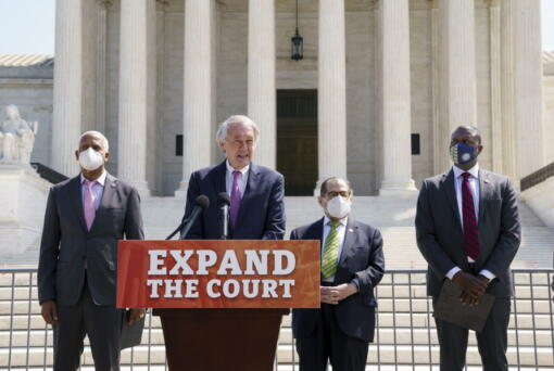 From left, Rep. Hank Johnson, D-Ga., Sen. Ed Markey, D-Mass., House Judiciary Committee Chairman Jerrold Nadler, D-N.Y., and Rep. Mondaire Jones, D-N.Y., hold a news conference outside the Supreme Court to announce legislation to expand the number of seats on the high court, on Capitol Hill in Washington, Thursday, April 15, 2021. (AP Photo/J.
