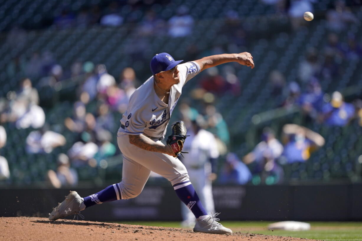 Los Angeles Dodgers starting pitcher Julio Urias throws against the Seattle Mariners in the fourth inning of a baseball game Tuesday, April 20, 2021, in Seattle. (AP Photo/Ted S.