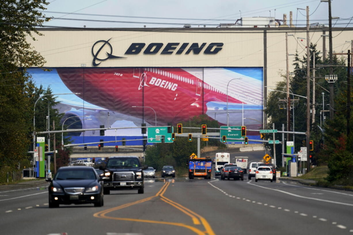 FILE - In this Oct. 1, 2020 file photo, traffic passes the Boeing airplane production plant, in Everett, Wash.  U.S. manufacturers expanded in March 2021 at the fastest pace in 37 years, a sign of strengthening demand as the pandemic wanes and government emergency aid flows through the economy.