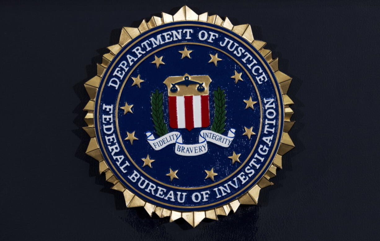 """FILE - This Thursday, June 14, 2018, file photo, shows the FBI seal at a news conference at FBI headquarters in Washington. The former top FBI agent in Albany, New York, was a """"skilled predator"""" who harassed eight women in one of the bureau's most egregious known sexual misconduct cases, according to a federal report obtained by The Associated Press."""