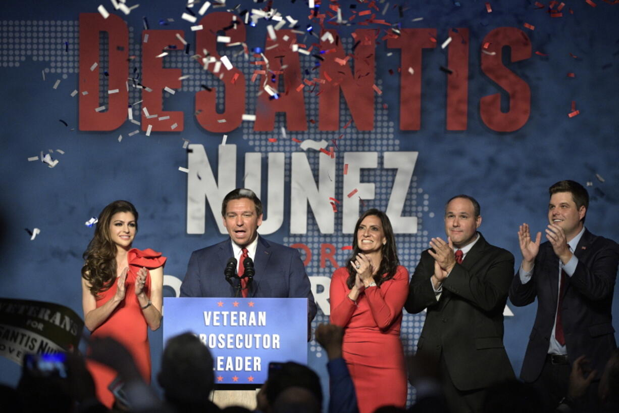 FILE - In this Nov. 6, 2018, file photo, Florida Gov.-elect Ron DeSantis, second from left, thanks supporters with his wife, Casey, left, Lt. Gov.-elect Jeanette Nunez, center; her husband, Adrian Nunez, second from right, and Rep. Matt Gaetz, R-Fla., after being declared the winner of the Florida gubernatorial race at an election party in Orlando, Fla. (AP Photo/Phelan M.