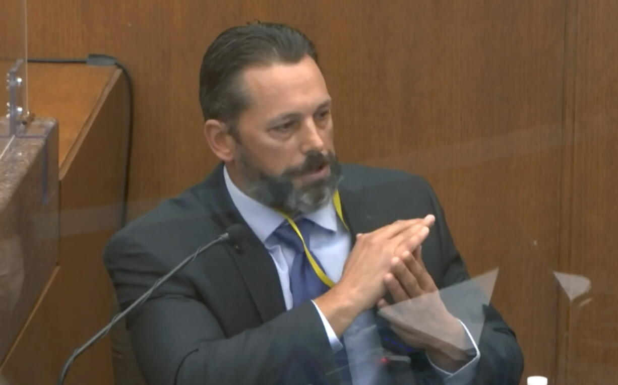In this image from video, Minneapolis Police Lt. Johnny Mercil, a use of force trainer, testifies as Hennepin County Judge Peter Cahill presides Tuesday, April 6, 2021, in the trial of former Minneapolis police Officer Derek Chauvin at the Hennepin County Courthouse in Minneapolis. Chauvin is charged in the May 25, 2020 death of George Floyd.
