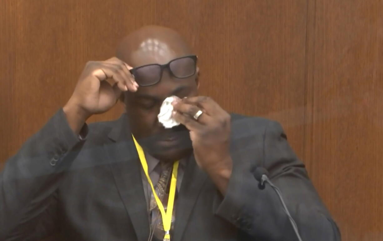 In this image from video, Philonise Floyd, brother of George Floyd, becomes emotional as he testifies as Hennepin County Judge Peter Cahill presides over court Monday, April 12, 2021, in the trial of former Minneapolis police Officer Derek Chauvin, in the May 25, 2020, death of George Floyd at the Hennepin County Courthouse in Minneapolis, Minn.
