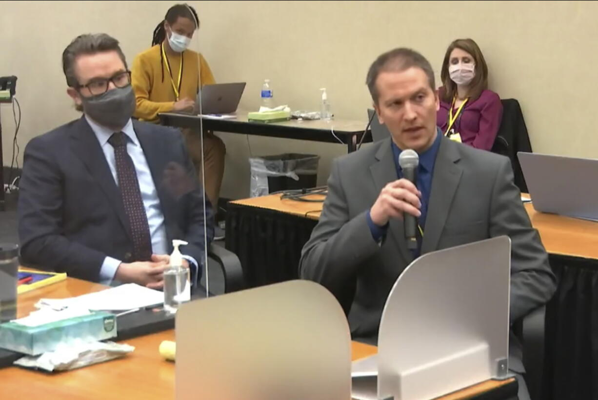 In this image from video, defense attorney Eric Nelson, left, and defendant, former Minneapolis police officer Derek Chauvin address Hennepin County Judge Peter Cahill during motions before the court Thursday, April 15, 2021, in the trial of Chauvin, at the Hennepin County Courthouse in Minneapolis. Chauvin is charged in the May 25, 2020 death of George Floyd.  Chauvin told the judge he will not testify on his own behalf.