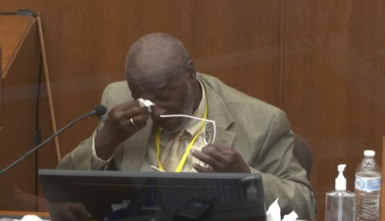 In this image from video, witness Charles McMillian becomes emotional as he answers questions as Hennepin County Judge Peter Cahill presides Wednesday, March 31, 2021, in the trial of former Minneapolis police Officer Derek Chauvin at the Hennepin County Courthouse in Minneapolis, Minn.  Chauvin is charged in the May 25, 2020 death of George Floyd.