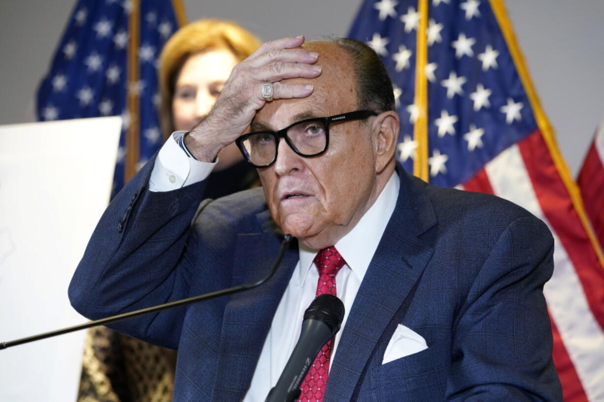 FILE - In this Nov. 19, 2020, file photo, former New York Mayor Rudy Giuliani, who was a lawyer for President Donald Trump, speaks during a news conference at the Republican National Committee headquarters in Washington. A law enforcement official tells the Associated Press that federal investigators have executed a search warrant at Rudy Giuliani's Manhattan residence. The former New York City mayor has been under investigation for several years over his business dealings in Ukraine.