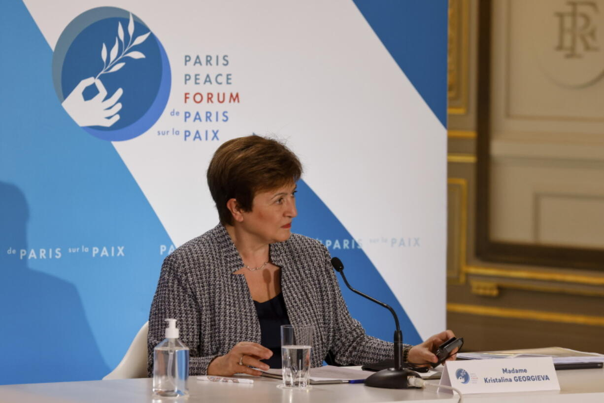 FILE - In this Nov. 12, 2020 file photo, International Monetary Fund Managing Director Kristalina Georgieva attends the Paris Peace Forum at The Elysee Palace in Paris.   Georgieva said Tuesday, March 30, 2021, that when the IMF releases its updated economic forecast next week, it will show the global economy growing at a faster pace than the 5.5% gain it projected at the start of the year.