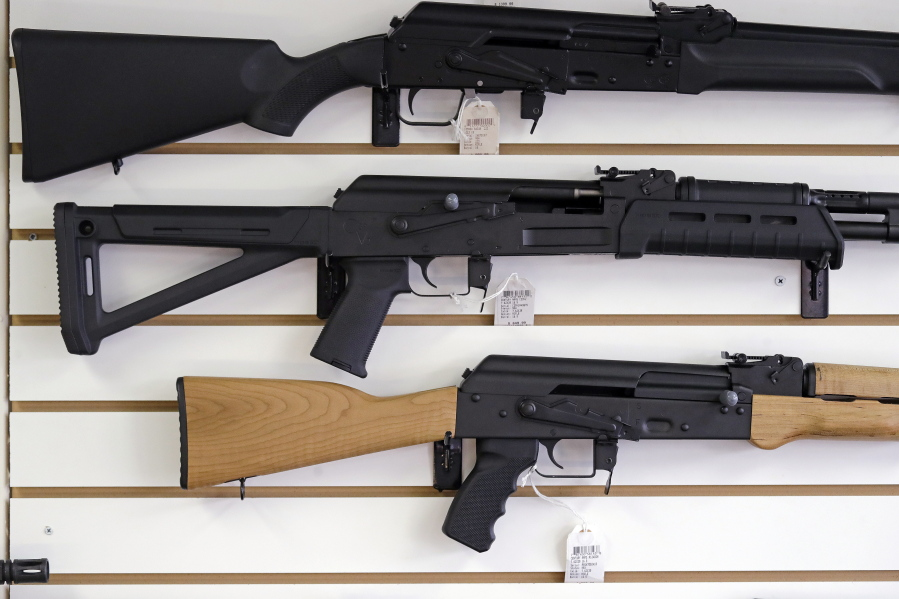 Semi-automatic rifles are displayed on a wall at a gun shop in Lynnwood.