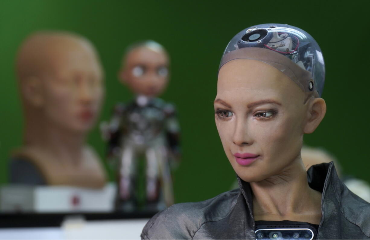 The close-up of the head of Sophia is seen at Hanson Robotics studio in Hong Kong on March 29, 2021. Sophia is a robot of many talents, she speaks, jokes, sings and even makes art. In March, she caused a stir in the art world when a digital work she created as part of a collaboration was sold at an auction for $688,888 in the form of a non-fungible token (NFT).