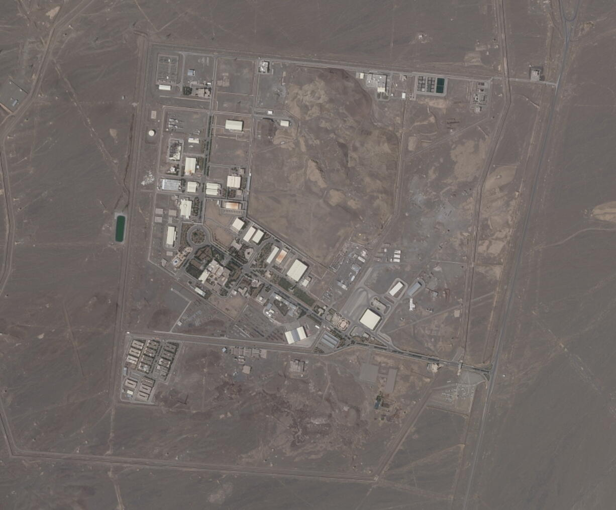 This satellite photo provided from Planet Labs Inc. shows Iran's Natanz nuclear facility on Wednesday, April 14, 2021. Iran began enriching uranium Friday, April 16, 2021, to its highest level ever at Natanz, edging closer to weapons-grade levels to pressure talks in Vienna aimed at restoring its nuclear deal with world powers after an attack on the site.