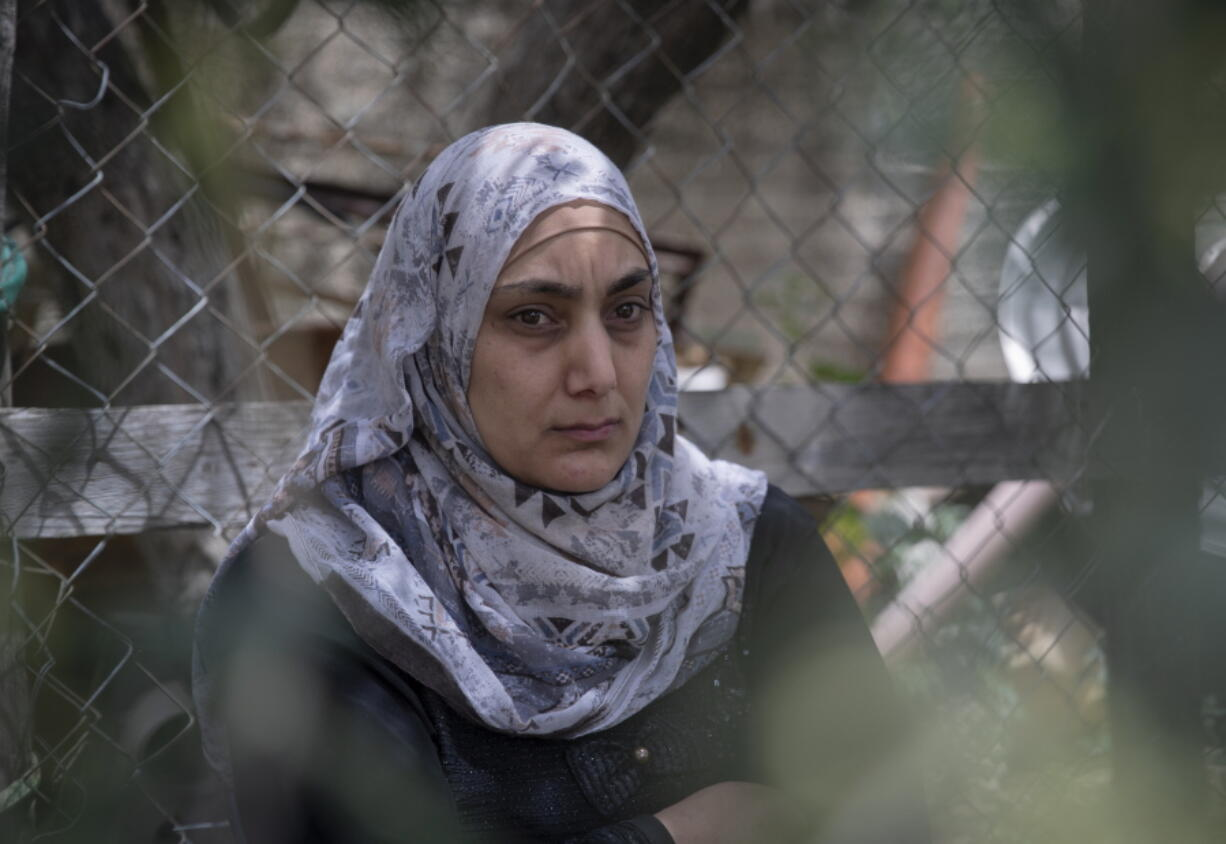 Somaya, the wife of Palestinian Osama Mansour, who was shot to death by Israeli soldiers at a temporary checkpoint in the occupied West Bank earlier this month, speaks to journalists at her family house, in the West Bank village of Biddu, west of Ramallah, Tuesday, April 20, 2021. Somaya, who was in the car with her husband and was wounded by the gunfire, says they followed the soldiers' instructions and posed no threat. The shooting death has revived criticism of the Israeli military's use of deadly force.