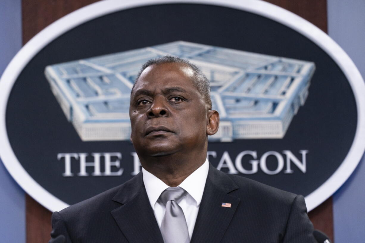 FILE - Secretary of Defense Lloyd Austin listens to a question as he speaks during a media briefing at the Pentagon in Washington, in this Friday, Feb. 19, 2021, file photo. U.S. Defense Secretary Lloyd Austin met Sunday, April 11, 2021, in Tel Aviv with his Israeli counterpart and reinforced American support.