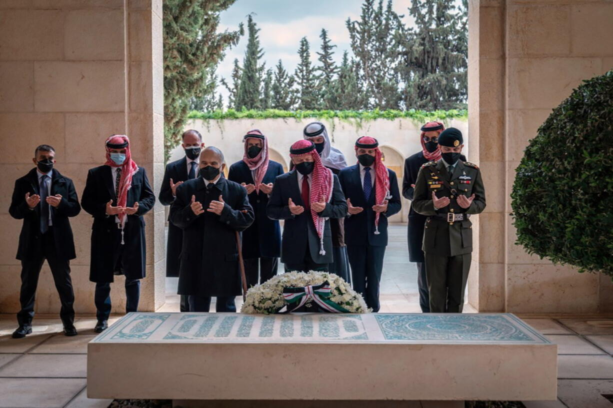 This photo from the Royal Court twitter account, shows Jordan's King Abdullah II, center, Prince Hamzah bin Al Hussein, second left, and others during a visit to the tomb of the late King Hussein, in Amman Jordan, Sunday, April 11, 2021. Abdullah II and his half brother Prince Hamzah have made their first joint public appearance since a palace feud last week. Members of the Jordanian royal family Sunday marked the centenary of the establishment of the Emirate of Transjordan, a British protectorate that preceded the kingdom.