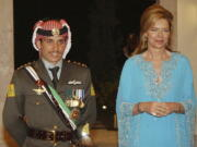 Jordan's Prince Hamza left, with his mother Queen Noor, right, stand together May 27, 2004, during his wedding ceremony in Amman, Jordan.
