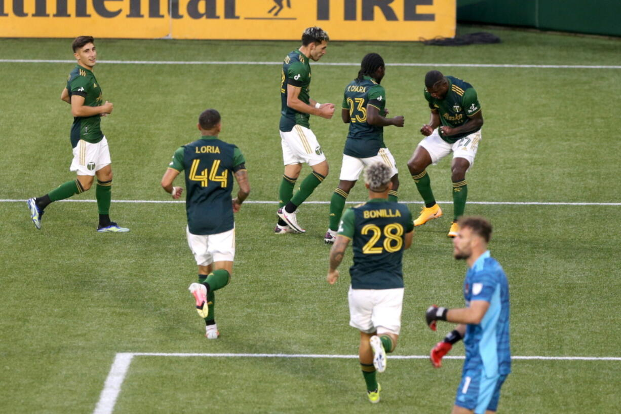 Portland Timbers celebrate a goal by Dairon Asprilla (27) during an MLS soccer match against the Houston Dynamo on Saturday, April 24, 2021, in Portland, Ore.