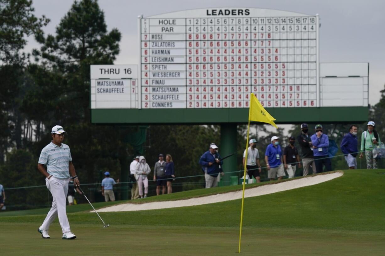 Hideki Matsuyama, of Japan, walks the the 17th green during the third round of the Masters golf tournament on Saturday, April 10, 2021, in Augusta, Ga. (AP Photo/David J.