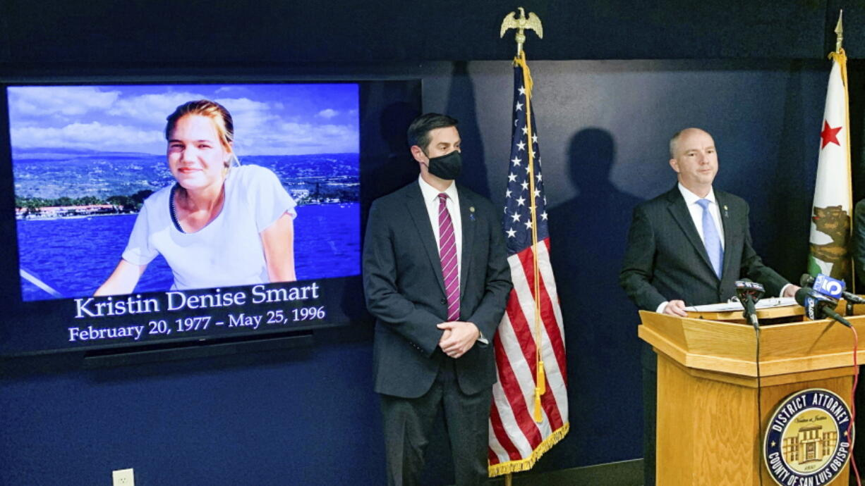 San Luis Obispo District Attorney Dan Dow announces a murder charge is filed against Paul Flores in the Kristin Smart case, as Deputy District Attorney Chris Peuvrelle listens at left, during a news conference, Wednesday, April 14, 2021, in Arroyo Grande, Calif. Smart, a missing California college who was killed in 1996 during an attempted rape by a fellow student, and the suspect's father helped hide her body, the San Luis Obispo County district attorney said Wednesday.