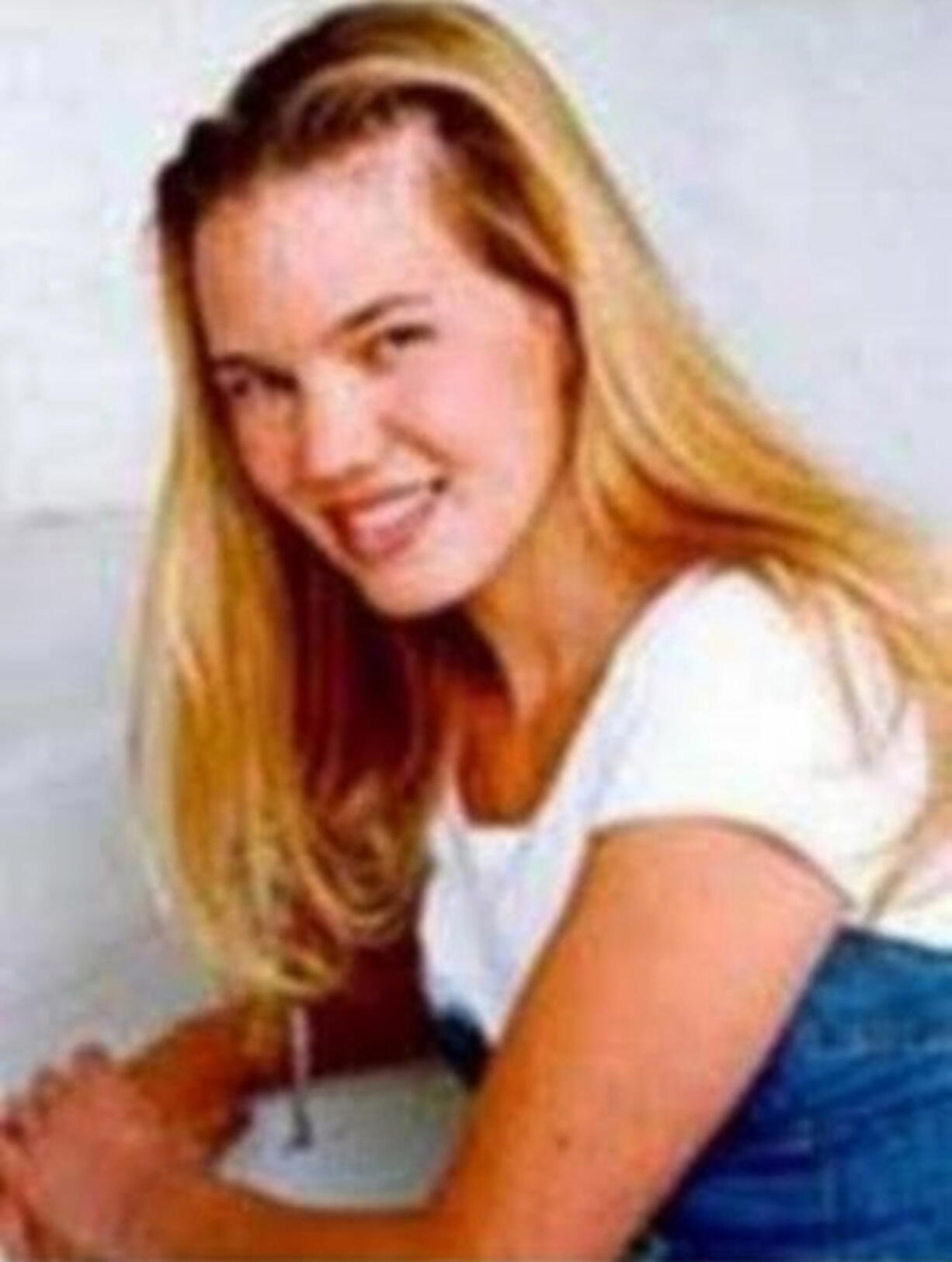 FILE - This undated photo released by the FBI shows Kristin Smart, the California Polytechnic State University, San Luis Obispo student who disappeared in 1996. The San Luis Obispo County district attorney has charged a former student, Paul Flores, with murder in her killing, and his father, Ruben Flores with helping hide her body.