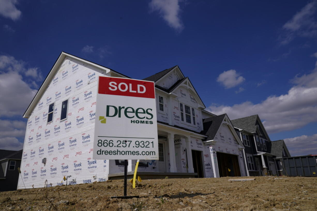 """FILE - In this Sept. 25, 2020 file photo, a """"sold"""" sign sits on a lot as new home construction continues in Westfield, Ind. Mortgage rates fell for the first time in more than two months as buyers continue to be stifled by high prices and limited supply."""