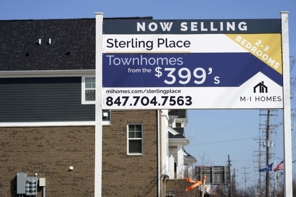 An advertising sign for building land stands in front of a new home construction site in Northbrook, Ill., Sunday, March 21, 2021.  Mortgage rates fell for a second straight week amid signs of economic improvement. Mortgage buyer Freddie Mac reports, Thursday, April 15,  that the benchmark 30-year home-loan rate declined to 3.04% this week from 3.13% last week.  (AP Photo/Nam Y.