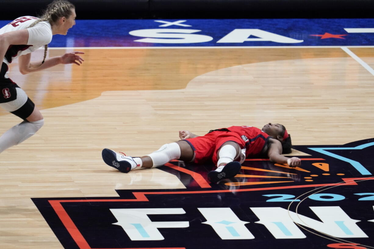 Arizona guard Aari McDonald lies on the court after missing a shot at the end of the championship game against Stanford in the women's Final Four NCAA college basketball tournament, Sunday, April 4, 2021, at the Alamodome in San Antonio. Stanford won 54-53.