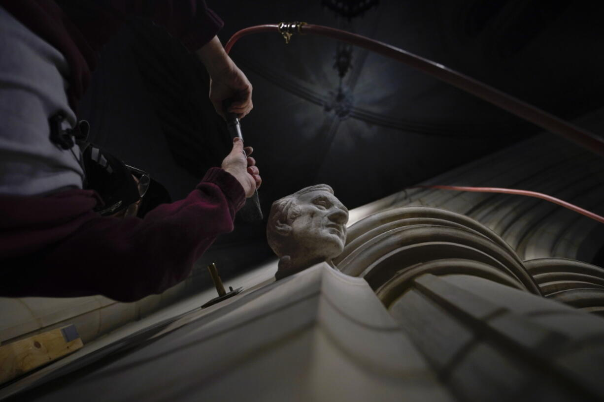 Washington National Cathedral stone carver Sean Callahan uses an air chisel to work on a sculpture of Holocaust survivor and Nobel Peace Prize winning author Elie Wiesel at the cathedral, Thursday, March 25, 2021. Wiesel, who died in 2016, became an outspoken advocate for human rights causes around the world, helped found the United States Holocaust Memorial Museum and was awarded the Nobel Peace Prize in 1986.