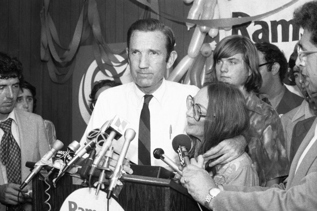 FILE - In this Wednesday, Sept. 14, 1976 file photo, Ramsey Clark, Democratic candidate for the U.S. Senate, center, speaks at Lincoln Center in New York. Ramsey Clark, the attorney general in the Johnson administration who became an outspoken activist for unpopular causes and a harsh critic of U.S. policy, has died, Friday, April 9, 2021. He was 93.