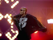 """FILE- DMX performs during the BET Hip Hop Awards in Atlanta on Oct. 1, 2011.  The family of rapper DMX says he has died at age 50 after a career in which he delivered iconic hip-hop songs such as """"Ruff Ryders' Anthem."""" A statement from the family says the Grammy-nominated rapper died at a hospital in White Plains, New York, """"with his family by his side after being placed on life support for the past few days. He was rushed to a New York hospital from his home April 2."""
