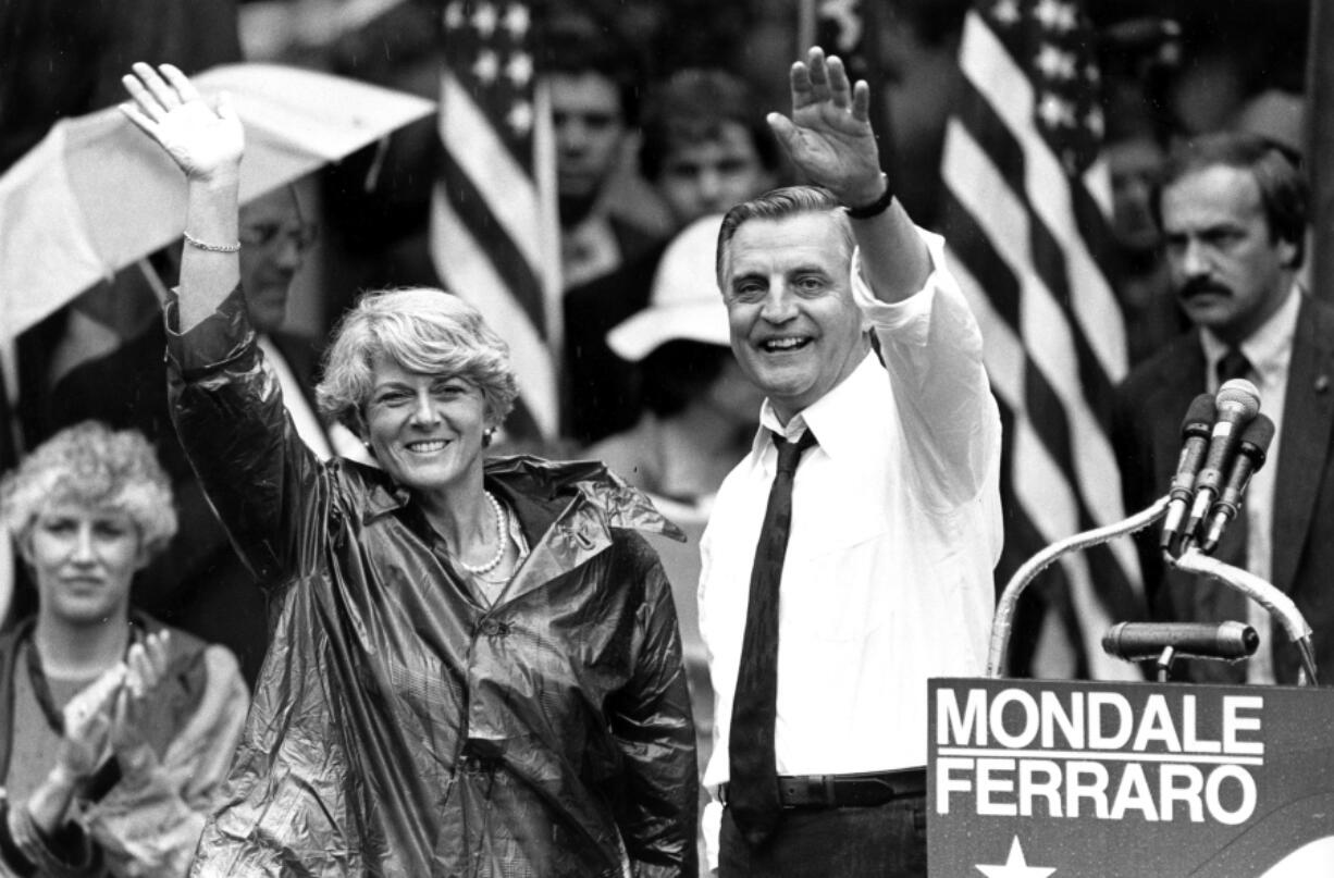 FILE - In this Wednesday, Sept. 5, 1984, file photo, Democratic presidential candidate Walter Mondale and his running mate, Geraldine Ferraro, wave as they leave an afternoon rally in Portland, Ore. Mondale, a liberal icon who lost the most lopsided presidential election after bluntly telling voters to expect a tax increase if he won, died Monday, April 19, 2021. He was 93.