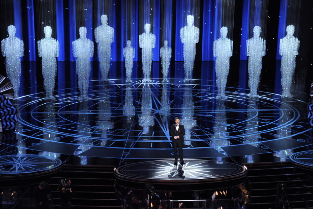 FILE - In this Feb. 26, 2017 file photo, host Jimmy Kimmel speaks at the Oscars in Los Angeles. Some people watch awards shows out of love, others because they love to hate. But this year, as ratings have taken a dive, will anybody tune in to the Oscars? Pushed by the pandemic from its usual berth of February or early March, the Academy Awards will be presented April 25 on ABC.