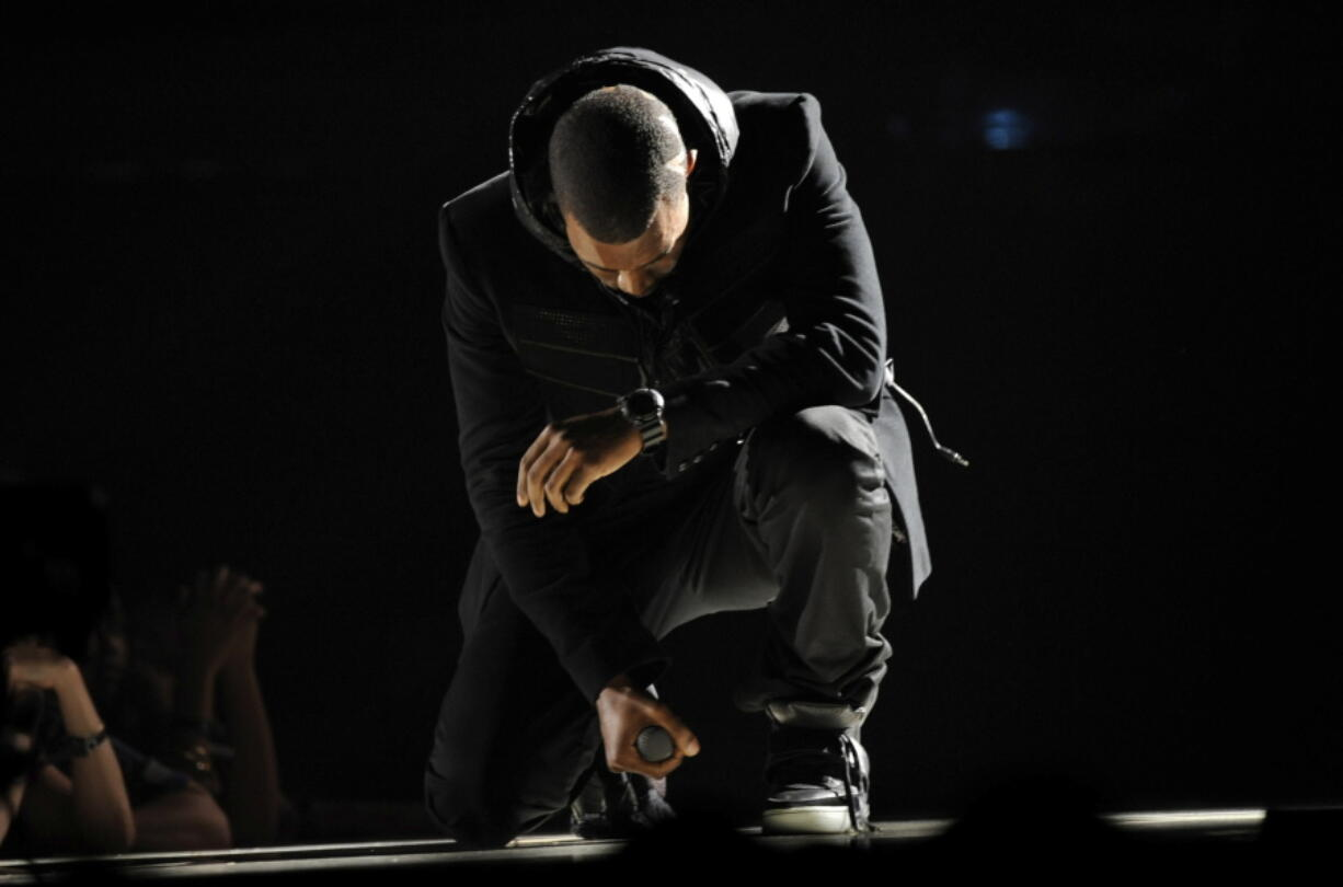 FILE - Kanye West performs at the 50th Annual Grammy Awards in Los Angeles on  Feb. 10, 2008. The Nike Air Yeezy 1 Prototypes worn by West during his performance were acquired for $1.8 million by social investing platform Rares.