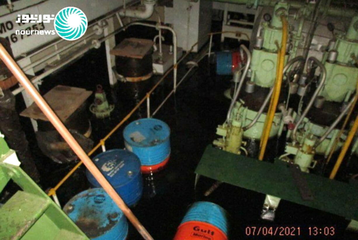 This photo released by Nournews on Thursday, April 8, 2021, shows the flooded engine room of the Iranian ship MV Saviz after being attacked in Red Sea off Yemen. An attack Tuesday on the Iranian cargo ship said to serve as a floating base for its paramilitary Revolutionary Guard off Yemen has escalated a yearslong shadow war on Mideast waters, just as world powers negotiate over Tehran's tattered nuclear deal.