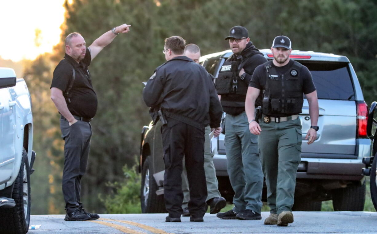 Law enforcement work the scene scene following a police chase Monday, April 12, 2021, in Carroll County, Ga. Georgia authorities say multiple officers were injured when the passenger of a car shot them during a police chase that ended with one suspect killed and the other arrested.
