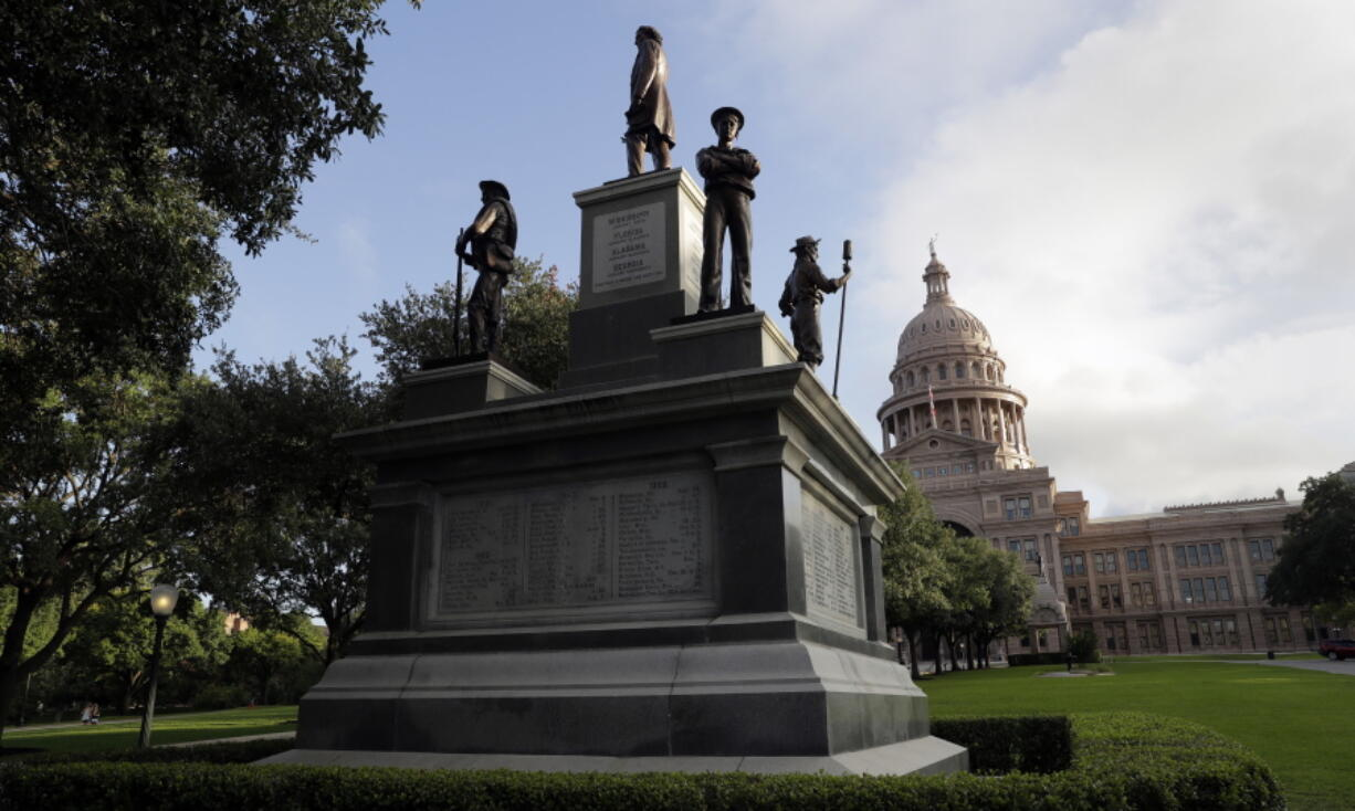 FILE - In this Aug. 21, 2017 file photo, the Texas State Capitol Confederate Monument stands on the south lawn in Austin, Texas. As a racial justice reckoning continues to inform conversations across the country, lawmakers nationwide are struggling to find solutions to thousands of icons saluting controversial historical figures.