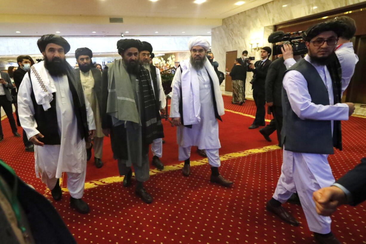 FLE - In this March 18, 2021, file photo, Taliban co-founder Mullah Abdul Ghani Baradar, center, arrives with other members of the Taliban delegation for attending an international peace conference in Moscow, Russia.