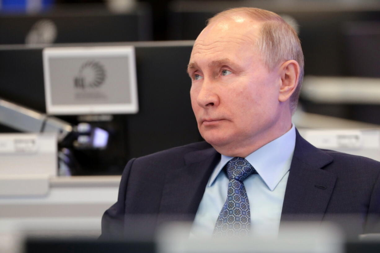 Russian President Vladimir Putin visits the Coordination Center of the Russian Government in Moscow, Russia, Tuesday, April 13, 2021. The centre was set up as a line of communication with the whole of Russia for analysing and collecting information, promptly using big data and solving arising problems.