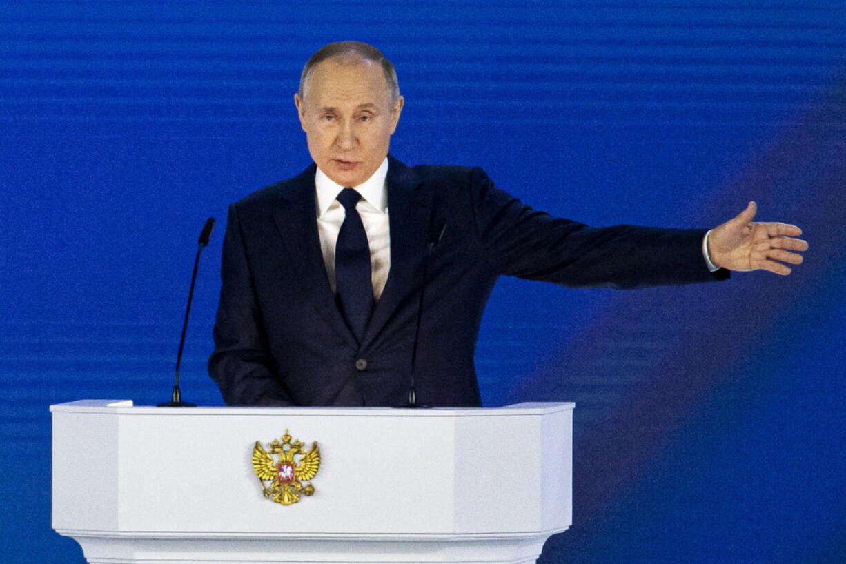 Russian President Vladimir Putin gestures as he gives his annual state of the nation address in Manezh, Moscow, Russia, Wednesday, April 21, 2021. Putin's state-of-the-nation speech comes amid a new surge in tensions with the West over a Russian troop buildup near the border with Ukraine and a hunger strike by jailed Russian opposition leader Alexei Navalny protesting a lack of adequate medical treatment in prison.