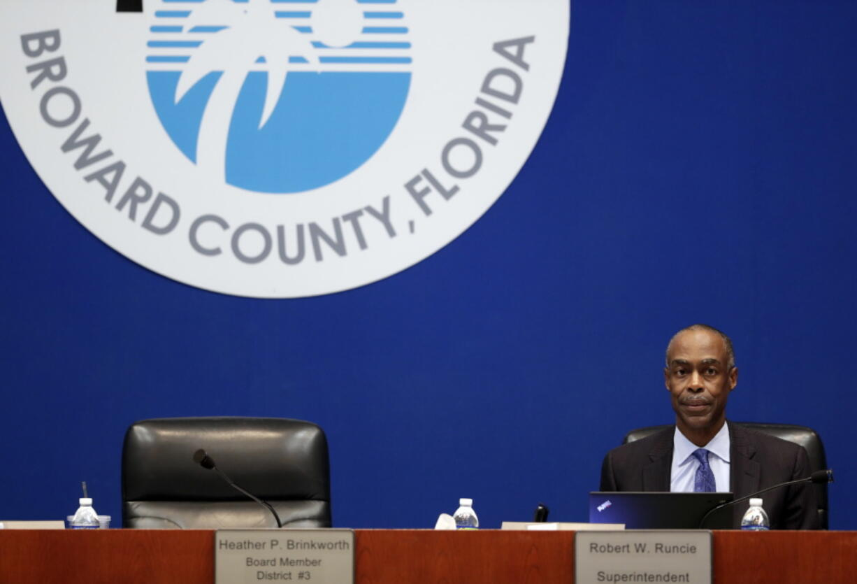In this March 5, 2019 photo, Broward County Schools Superintendent Robert Runcie waits for the start of a meeting of the Broward County School Board  in Fort Lauderdale, Fla.  The superintendent of the Florida school district where 17 students and staff died in a 2018 high school massacre has been arrested on a perjury charge. Jail records show Broward County Schools Superintendent  Runcie was arrested Wednesday, April 21, 2021 by the Florida Department of Law Enforcement.