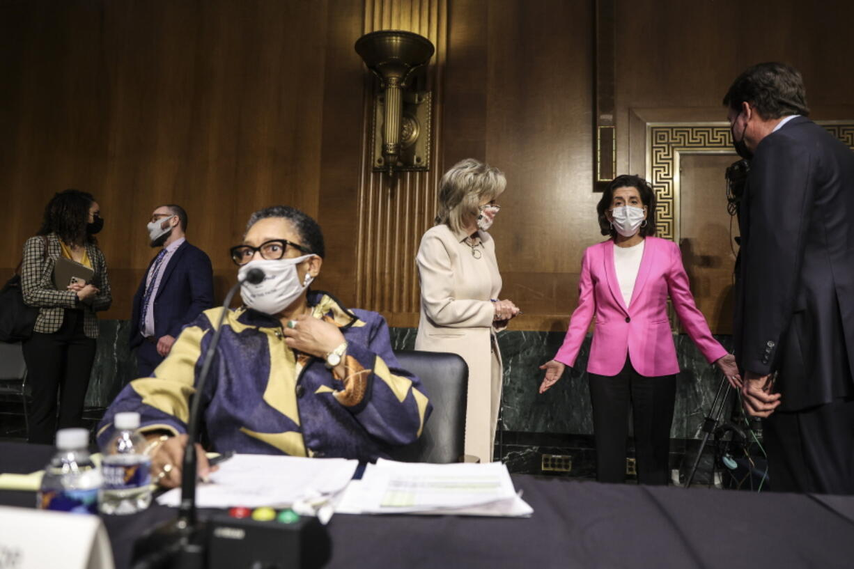 Commerce Secretary Gina Raimondo, second right, speaks with, Sen. Cindy Hyde-Smith, R-Miss., and Sen. Bill Hagerty, R-Tenn., right, as Housing and Urban Development Secretary Marcia Fudge, left, arrives for a Senate Appropriations Committee hearing on Capitol Hill, Tuesday, April 20, 2021 in Washington.