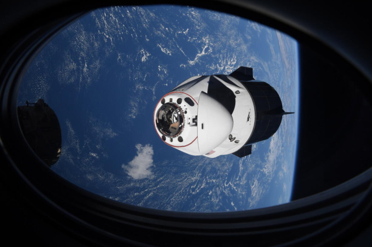 In this Saturday, April 24, 2021 photo made available by NASA, the SpaceX Crew Dragon capsule approaches the International Space Station for docking. SpaceX's four astronauts had barely settled into orbit on Friday, April 23, when they were ordered back into their spacesuits because of a potential collision with orbiting junk. It turns out there was no threat, the U.S. Space Command acknowledged Monday, April 26. The error is under review.