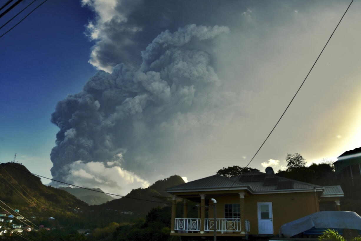 Ash rises into the air as La Soufriere volcano erupts on the eastern Caribbean island of St. Vincent, Tuesday, April 13, 2021.